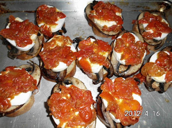 Place toasted side of crostini up, untoasted side on baking sheet.  Place portabello...