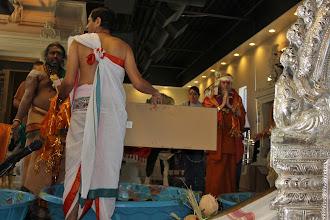 Photo: Satguru is having darshan through the mirror of the deities