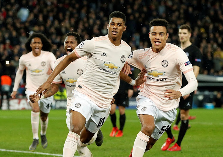 Manchester United's Marcus Rashford celebrates scoring their third goal with Mason Greenwood and Fred.