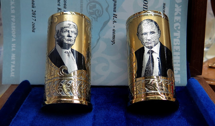 A souvenir depicting American President Donald Trump and Russian President Vladimir Putin is seen at the airport in Saint Petersburg, Russia, on July 5 2018. Picture: REUTERS/MAX ROSSI