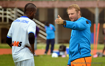 Photo: Assistant Coach Tom Harris speaks with David Simbo   [Training camp ahead of Leone Stars v Seychelles Game in Freetown on 19 July 2014 (Pic: Darren McKinstry)]