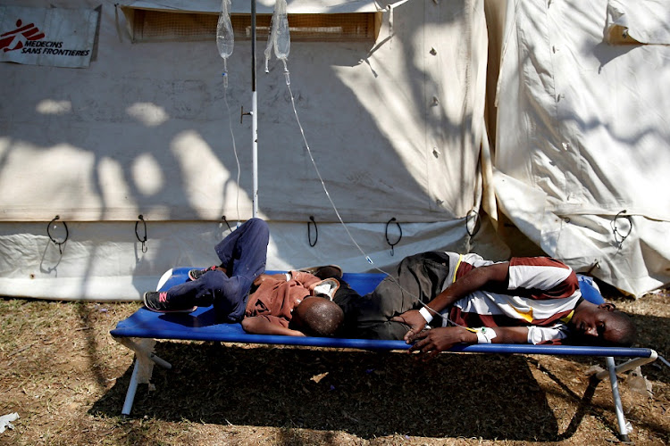 Patients await treatment at a makeshift cholera clinic in Harare on September 11 2018. Picture: REUTERS/Philimon Bulawayo