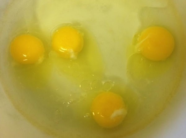 In a large bowl, add the water, eggs, and oil.  Mix for a...