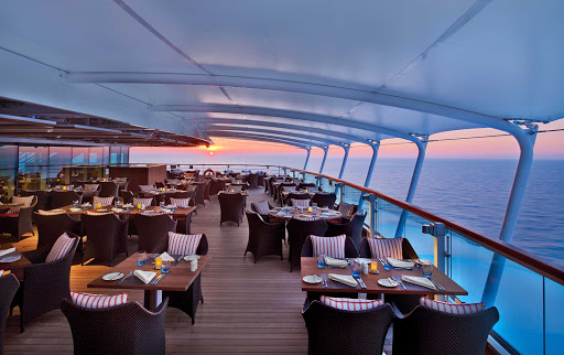 Enjoy al fresco dining on deck in The Colonnade aboard Seabourn Encore.