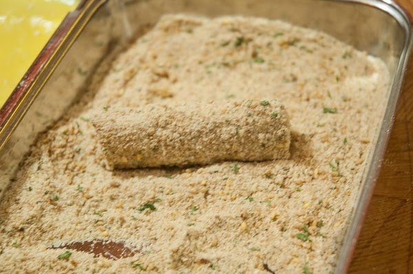 Shake off and roll into the breadcrumb/sesame mixture.