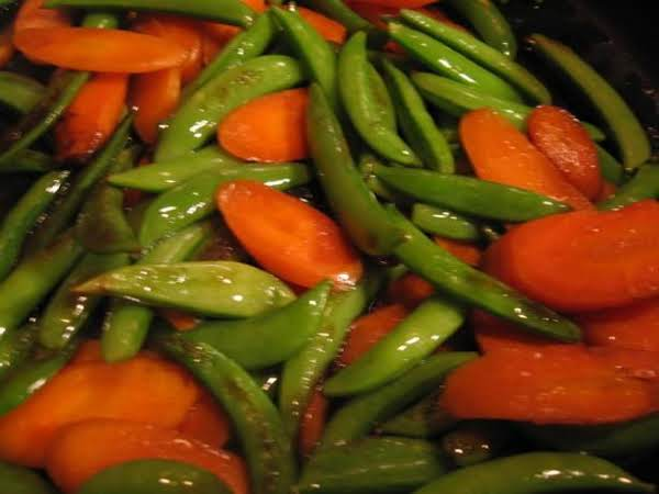Carrots And Pea Pods In Orange Sauce