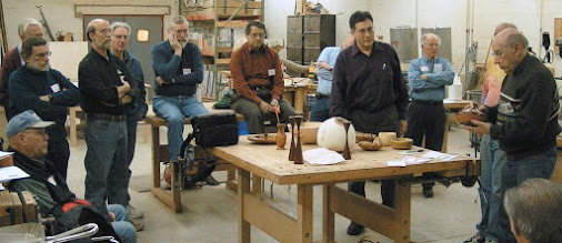 Photo: A rapt audience listens to David Jacobowitz describe his laminated vessel.