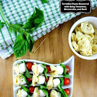 Tortellini Appetizers with Baby Tomatoes, Mozzarella, and Basil.