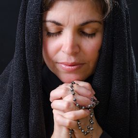 Catholic Woman Praying: Religious Image by Toronto-Images .Com - People Portraits of Women ( prayer, home, belief, church, happiness, people, worship, portrait, love, religion, wearing black, spiritual, rosary, woman, jesus, christ, pray, devotion, devotional, religious, hope )
