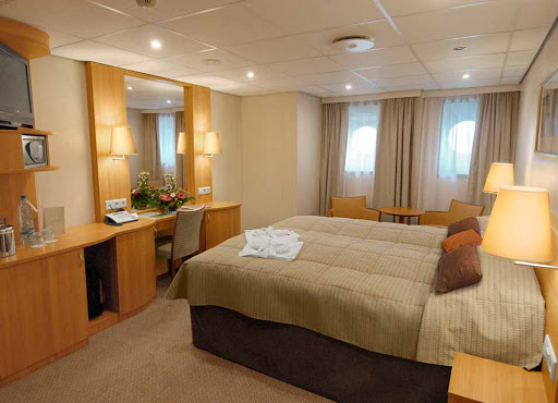 Viking-Truvor-stateroom2.jpg - Relax after a busy day of sightseeing in Russia in your luxurious suite on Viking Truvor.