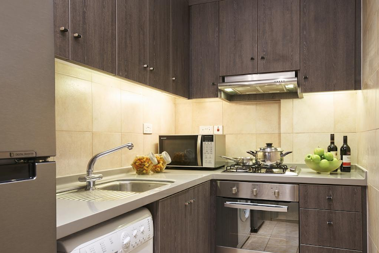 Full kitchen at Penang Rd Serviced Apartments, Orchard Road