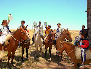 Photo: XO's even survive this.  Kids going to school on their horses in Latin America!