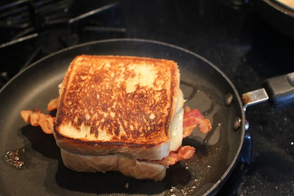 Grill until toast is brown on both sides and cheese is melted. Serve with...