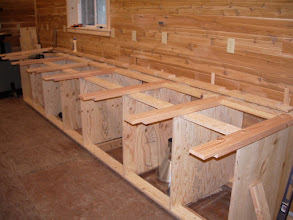"""Photo: As you can see, I'm using Norm's design - with a few modifications. The top will be 1"""" plywood (left over from the floor) on top of a 2x4 base. The 2x4's are joined using half-laps."""