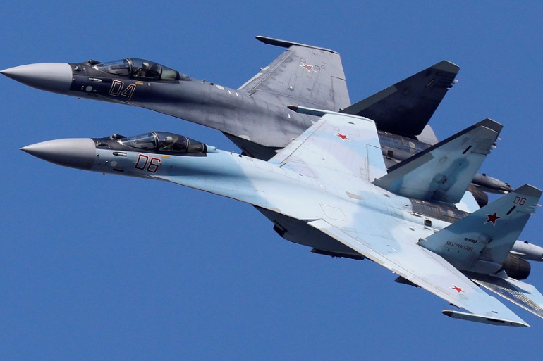 Sukhoi Su-35 jet fighters of the Sokoly Rossii (Falcons of Russia) aerobatic team fly in formation during a rehearsal for an airshow in Krasnoyarsk, Russia [File: Ilya Naymushin/Reuters]