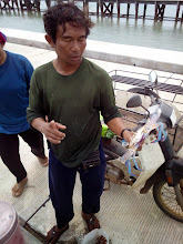 Photo: ran into this fisherman and his wife on the pier. they did well today. 2000 Baht worth of catch in half day
