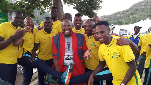 Singer Dr Malinga posing with Mamelodi Sundown' players on 5 January 2016.