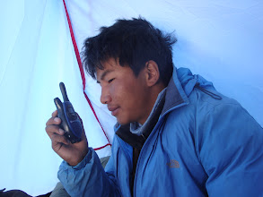 Photo: trying contact the members on top and base camp from summit camp