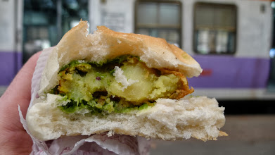 Photo: Yummm.  Potato bread, battered potato, coriander, and spices.  Adarsh, what was this called again?
