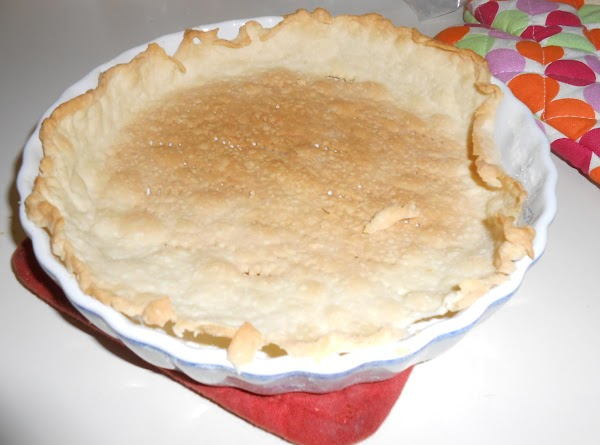 Press onto bottom and up sides of pan; trim pastry even with edge (discard...