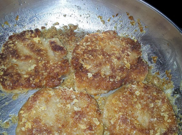 heat frying pan with oil on medium heat. place coated patties in frying pan cook...
