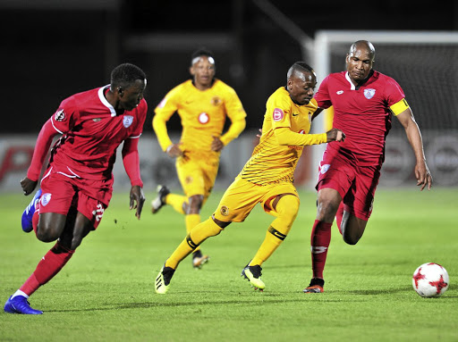 Khama Billiat of Kaizer Chiefs waltzes past Bangaly Keita, left and Paulus Masehe of Free State Stars during their league match in Bethlehem on Tuesday.