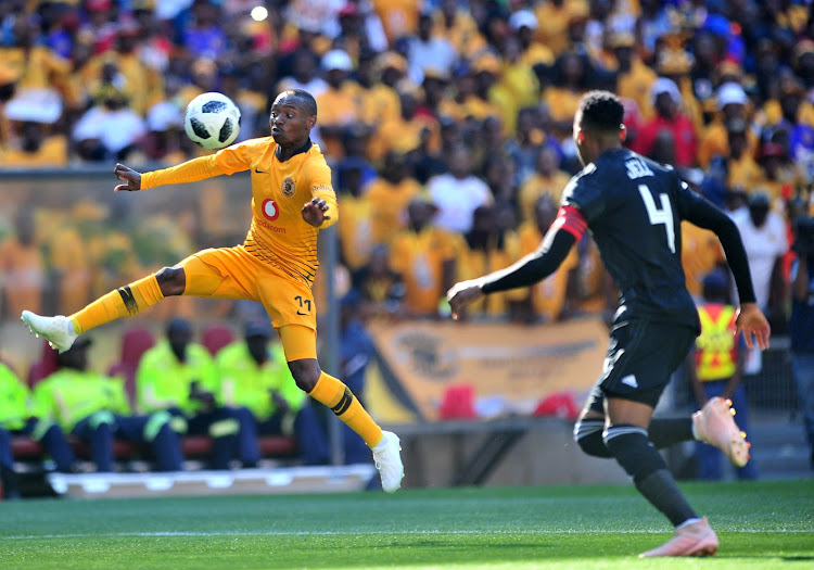 Khama Billiat of Kaizer Chiefs challenged by Happy Jele of Orlando Pirates during the Absa Premiership 2018/19 match between Orlando Pirates and Kaizer Chiefs at FNB Stadium, Johannesburg on 27 October 2018.