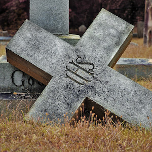 Covered by the cross.jpg