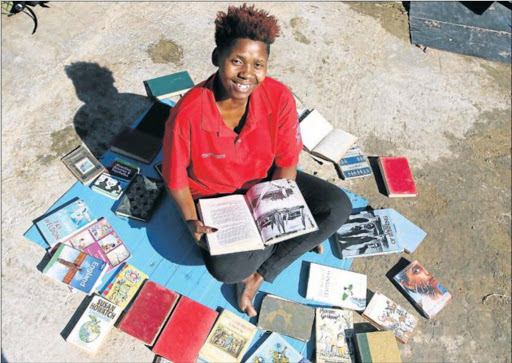 ROLE MODEL: Luleka Gweje, founder of Abanqobi Reading Club in Orange Grove, where she helps kids to read Picture: MICHAEL PINYANA