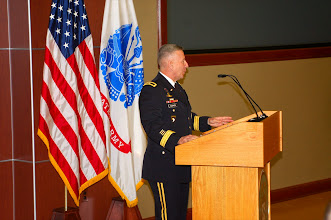 Photo: CGSC Deputy Commandant Brig. Gen. Chris Hughes provides welcome remarks to the attendees of the 2014 Fort Leavenworth Ethics Symposium.