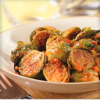 Roasted Brussels Sprouts With Sun-Dried Tomato Pesto.