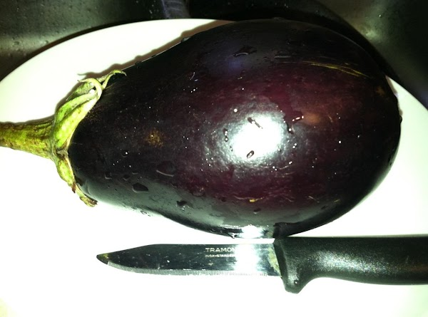 Eggplant about to be sliced in thin slices about 1/4 inch thick lengthwise.