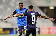 Thabo Nodada of Cape Town City celebrates with goalscorer Kermit Erasmus during a match.