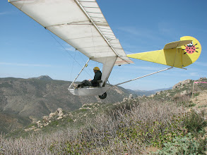 Photo: Goat4 lifts off from the Horse Canyon, (San Diego, California) launch slope on April 1, 2007.  This shows myself, the author, at the controls, performing a reasonably stable rolling  takeoff. With my original tail art I am setting the spring fashion trends.  Photo by D. Metzgar