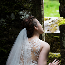 Waiting for a Prince by Charles Shope - Wedding Bride ( outdoor, bride, green, castle, natural light, ballysaggartmore towers, wedding, ireland, stone )
