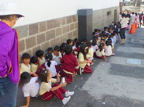 Photo: Sheila at the end of the line of preschoolers waiting to get the tour of the Presidential Palace