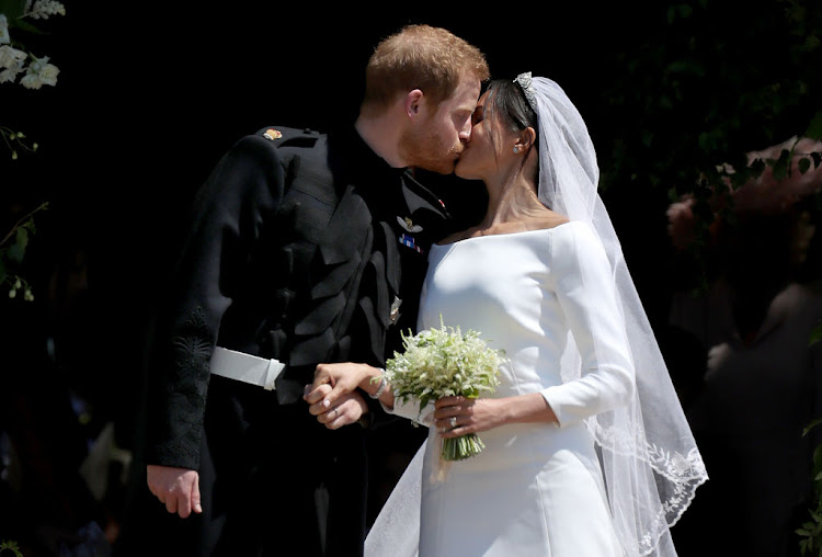 Prince Harry and Meghan Markle kiss outside St George's Chapel in Windsor Castle after their wedding.