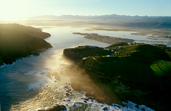 An areal view of the ocean flowing through the Knysna Heads into the Knysna lagoon.