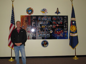 Photo: Space Vehicle Mockup Facility Supervisor Tim Reynolds, standing with his memorial collage for Apollo 1, Challenger and Columbia