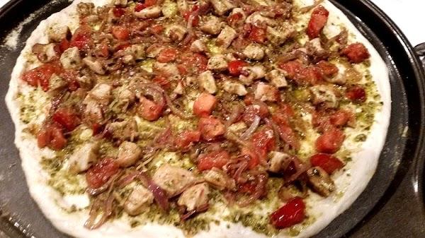 Next, spread chicken pesto mixture evenly over crust.