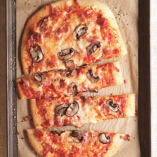 Three-Cheese Pizza with Pancetta and Mushrooms.