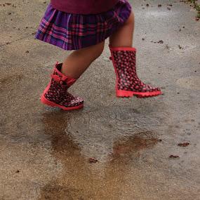 Rain Dancer by Lyle Hatch - Babies & Children Children Candids ( skirt, dancing, patio, cute, concrete, kid, girl, in the rain, raining, plaid, pink, stomping, wet, puddle, cement, boots )