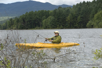 Photo: Glenn Gagnon of E. Montpelier, VT sets out for some fishing from Waterbury Ctr State Park. Photo by Karen Pike