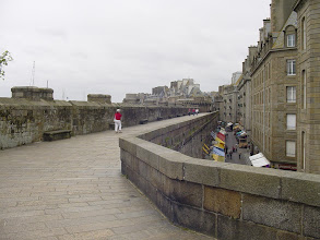 Photo: We move along to St-Malo, with Madame in her can't-miss-me red jacket for a blustery day on the ramparts.