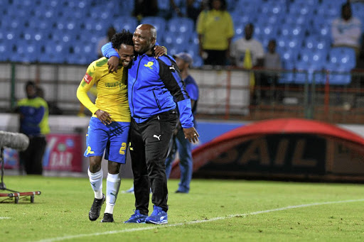 Sundowns' Percy Tau and coach Pitso Mosimane celebrate one of the team's best moments this year. / Lefty Shivambu / Gallo Images