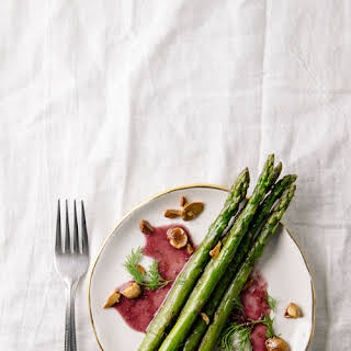 Skillet Asparagus With Blood Orange Sauce And Poached Almonds.