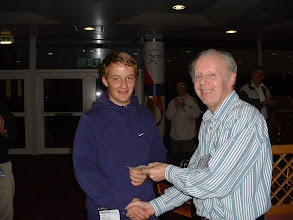 Photo: Adam Burroughs of Brown Jack receives the 2011 Wiltshire Rapidplay Team Tournament Individual winner prize money from the Wiltshire County Chess Association Tournament Secretary Tony Ransom.
