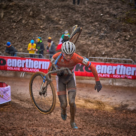 Determination by Marco Bertamé - Sports & Fitness Cycling ( 2017, uphill, muddy, orange, mud, world championship, determined, number, cyclocross, 12, bieles, bicycle )