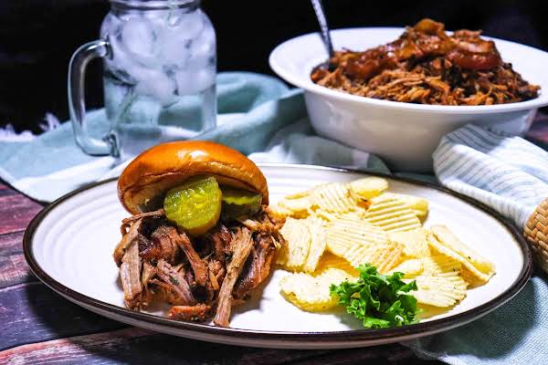 Amazing Bbq Pulled Pork On A Brioche Roll With Pickles.