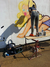 "Photo: Street Artist ""Saki"" getting a little help from her shadow at Gloucester Paint Jam 2014"
